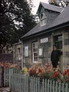 Garden Flowers Photos - Policeman And Dog Stand At Police by B. Anthony Stewart