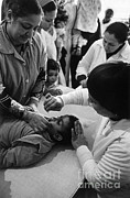 Polio Vaccine Photos - Polio Vaccination by Bernard Wolff
