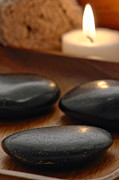 Candle Prints - Polished Stones in a Spa Print by Olivier Le Queinec