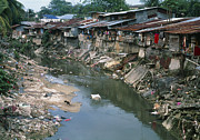 Polluted Framed Prints - Polluted River Running Through A Malaysian Slum Framed Print by David Nunuk