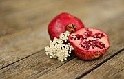 Rustic Photos - Pomegranate And Flowers On Tabletop by Anna Hwatz Photography Find Me On Facebook