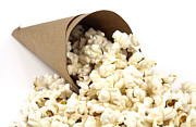 Salty Treat Posters - Popcorn in paper cone Poster by Blink Images