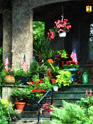 American Flags Framed Prints - Porch With Geraniums and American Flags Framed Print by Susan Savad