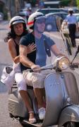 Portofino Italy Photo Posters - Portofino scooter couple Poster by Neil Buchan-Grant