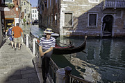 Gondolier Photo Framed Prints - Portrait of a Gondolier in Venice Framed Print by Madeline Ellis