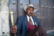 Eye Contact Photos - Portrait of a man wearing a 1930s-style suit and smoking a cigar in Havana by Sami Sarkis