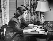 Desk Photo Prints - Portrait Of Woman Writing Letter At Desk Print by George Marks