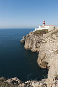 Water Over Rock Photos - Portugal, Algarve, Sagres, Lighthouse On Cliff At Atlantic Ocean by Westend61