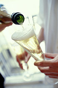 Champagne Glasses Photo Posters - Pouring Champagne Poster by David Munns