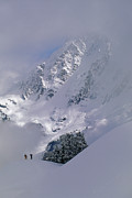 Winter Scenes Photos - Powder Skiers Head Out-of-bounds by Gordon Wiltsie