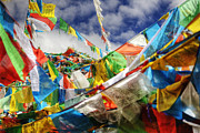 Tibet Prints - Prayer Flags Atop A Mountain Summit Print by Pete Ryan