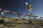 Tibet Framed Prints - Prayer Flags Blow In The Wind Atop Framed Print by Gordon Wiltsie