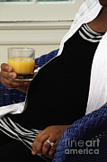 Juice Posters - Pregnant Woman Drinking Orange Juice Poster by Photo Researchers
