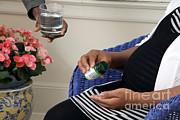Pregnant Woman Taking Folic Acid Print by Photo Researchers