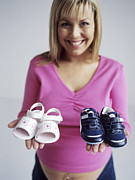Caring Mother Posters - Pregnant Woman With Baby Shoes Poster by Ian Boddy
