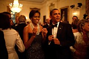 Barack Obama Photo Framed Prints - President And Michelle Obama Applaud Framed Print by Everett