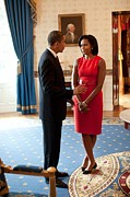 Dresses Photo Framed Prints - President And Michelle Obama Talk Framed Print by Everett