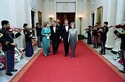 Hillary Framed Prints - President And Nancy Reagan Walking Framed Print by Everett