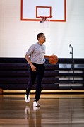 T-shirt Photos - President Barack Obama Dribbles by Everett