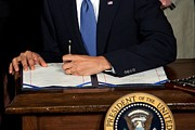 Legislation Prints - President Barack Obama Signs The Health Print by Everett