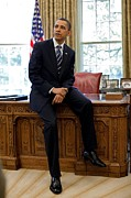 Barack Photo Framed Prints - President Barack Obama Sits On The Edge Framed Print by Everett