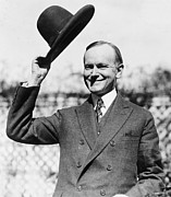 Coolidge Prints - President Calvin Coolidge tips is hat Print by International  Images