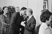 Black Muslims Framed Prints - President Jimmy Carter Greets Mohammed Framed Print by Everett