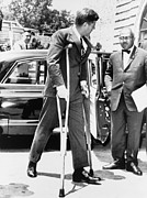 Crutches Posters - President John F. Kennedy On Crutches Poster by Everett