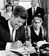 First Ladies Prints - President John Kennedy Signs A Joint Print by Everett