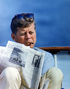 Newspaper Photo Framed Prints - President John Kennedy Smoking A Cigar Framed Print by Everett