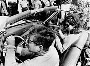 President Kennedy Drives An Open Car Print by Everett
