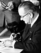 African-americans Framed Prints - President Lyndon Johnson Signing Framed Print by Everett