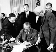African-americans Framed Prints - President Lyndon Johnson Signs The 24th Framed Print by Everett