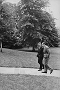 Kissinger Prints - President Nixon Walking With Kissinger Print by Everett