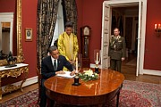 First-lady Framed Prints - President Obama And Michelle Obama Sign Framed Print by Everett