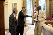 Gestures Photo Framed Prints - President Obama Gives A Fist-bump Framed Print by Everett