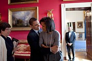 Presidents Wives Framed Prints - President Obama Hugs First Lady Framed Print by Everett