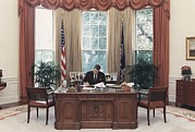 Candid Family Portraits Posters - President Reagan Working At His Desk Poster by Everett