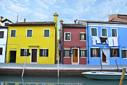 Colorful Houses Prints - Primary colors in Burano Italy Print by Rebecca Margraf