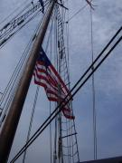Shades Of Red Posters - Proud Flag Tall Ship Poster by Carol Komassa