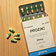 Antidepressant Prints - Prozac Pack With Pills On Wooden Surface Print by Damien Lovegrove