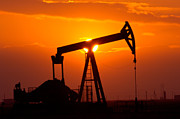 Landscape Photo Prints - Pumping Oil Rig At Sunset Print by Connie Cooper-Edwards