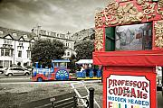 Punch Framed Prints - Punch and judy and fun  train pleasure rides- seaside attractions in Llandudno Framed Print by Mal Bray