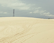 Footprint Posters - Pylon Atop Sand Dune Poster by Photograph by Chris Round