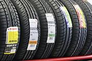 Labelled Posters - Rack Of Car Tyres Poster by Ria Novosti