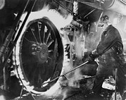 Metal Tires Framed Prints - Railroad Worker Sweating A Tire Framed Print by Everett