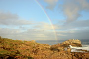 Overcast Day Posters - Rainbow on Ocean by a rocky shore Poster by Sami Sarkis