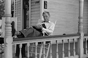 Rocking Chairs Photos - Reading A Good Book. Middle Age Man by Everett