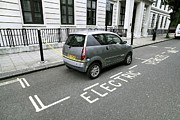 Electric Car Framed Prints - Recharging An Electric Car Framed Print by Martin Bond