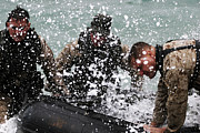 Inflatable Photos - Reconnaissance Marines Pull A Zodiac by Stocktrek Images